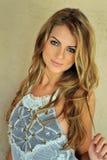 Glamor blond girl posing pretty outside wearing designers lingerie Stock Photography