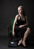 Glamor in a chair Stock Photos