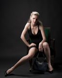 Glamor in a chair Stock Images