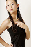 Glamor Chinese girl. In black silk cloth Royalty Free Stock Images