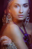 Glamor girl in beautiful jewelry motion blur Stock Images
