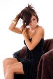 Glamor girl holding hair Stock Images