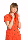 Glamor girl in a orange dress isolated Stock Images
