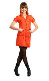 Glamor girl in a orange dress isolated Royalty Free Stock Photography