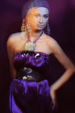 Glamor girl in violet evening dress in motion blur Stock Photography