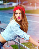 Glamor lifestyle blond woman girl  model in casual jeans shorts cloth Stock Photo