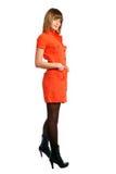 Glamor Mädchen in einem orange Kleid getrennt stockfotos