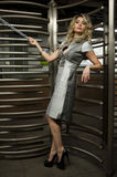 Glamor model standing by entrance with revolving door to subway Stock Images