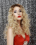 Glamor. Portrait of Luxurious Classy Blond with Sexy Red Lips Stock Photo