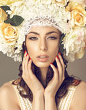 Glamor portrait of woman with flowers Stock Photo