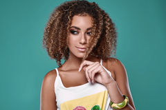 Glamor swag black hipster woman model with curly hair. Sensual portrait of glamor swag black hipster woman model with curly hair posing on colorful background in Stock Images