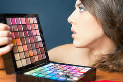 Glamor woman with colorful palette for fashion makeup Stock Image