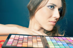 Glamor woman with colorful palette for fashion makeup Stock Images