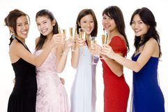 Glamorous #10. Five beautiful young women raise their glasses for a toast Stock Photo