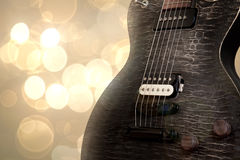 Glamorous. A Gibson les paul guitar shot againts bokeh background Royalty Free Stock Photography