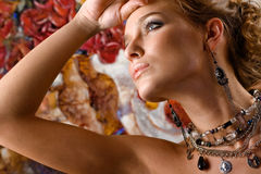 Glamorous. A portrait of a young glamorous woman wearing stylish necklace and pierced earrings Stock Photo