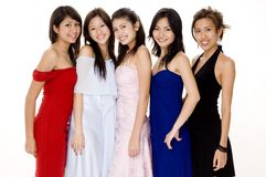 Glamorous #5. Five beautiful young women in evening dresses Stock Image