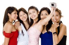 Glamorous #6. Five attractive young women in evening dresses take their photos Stock Photos