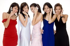 Glamorous #8. Five pretty women in evening dresses all talking on phones Royalty Free Stock Photography