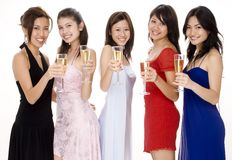 Glamorous #9. Five attractive young asian women in evening wear toast with champagne Royalty Free Stock Photos