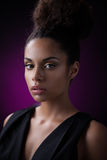 Glamorous African Woman. Portrait of a glamorous young African woman against a purple background Stock Photography