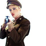 Glamorous army officer aiming a rifle Stock Photos