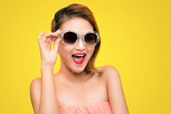 Glamorous asian fashion model posing in vivid colourful clothes Royalty Free Stock Photos