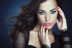 Glamorous Beauty. Portrait of a beautiful glamorous women posing Royalty Free Stock Photography