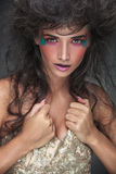 Glamorous beauty woman pulling up her elegant dress. Royalty Free Stock Image