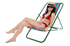 Glamorous bikini model relaxing on reclining chair Royalty Free Stock Photography