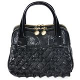 Glamorous black handbag in the style of ROCK Royalty Free Stock Photography