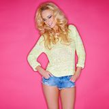 Glamorous blond in trendy skimpy denim shorts Stock Images