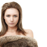 Glamorous blond woman. Fashion girl in fur Stock Photos