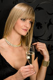 Glamorous blond woman party dress drink champagne. Glass looking aside Stock Photo