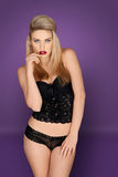 Glamorous blonde in lacy black lingerie Stock Image