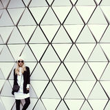 Glamorous blonde standing at the wall. urban fashion style Royalty Free Stock Photography