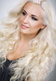 Glamorous Blonde with Waved and Frizzy Hair. Classy Glamorous Blonde with Waved and Frizzy Hair Royalty Free Stock Photo