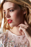 Glamorous blonde woman looking away, vertical portrait Royalty Free Stock Image