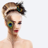 Glamorous Blonde Woman with Perfect Hairstyle, Makeup. And Peacock Feathers Stock Photos