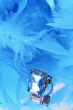 Glamorous blue diamond and feather boa Royalty Free Stock Photos