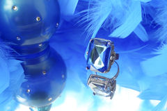Glamorous blue diamond and feather boa Royalty Free Stock Photography