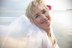 Glamorous bride on the beach Stock Photo