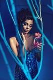 Glamorous brunette beauty holding a bottle of perfum Royalty Free Stock Images
