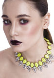 Glamorous brunette dark make-up, with the decoration, looking at Stock Photo