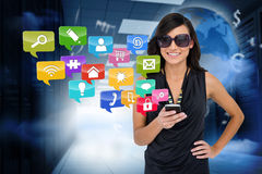 Glamorous brunette using smartphone with app icons Stock Photos