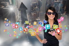 Glamorous brunette using smartphone with app icons Stock Images