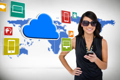 Glamorous brunette using smartphone with cloud and icons Stock Photo
