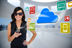 Glamorous brunette using smartphone with cloud and icons Stock Images