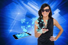 Glamorous brunette using smartphone with email symbols Royalty Free Stock Photos