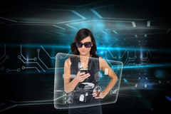 Glamorous brunette using smartphone with interface Stock Photos